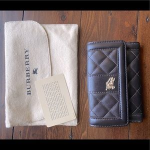 Burberry leather wallet in brown - like new